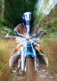 Motorbike speeding in frontal. Bike rider zooms through the speed of light. Lens zoom effect Royalty Free Stock Photo