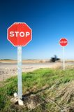 Motorbike through stop traffic signs Royalty Free Stock Photography