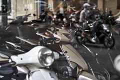 Motorbike store with panoramic windows with traffic reflection stock images