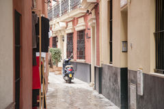 Motorbike in Street in the Santa Cruz Neighbourhood of Seville Royalty Free Stock Photo