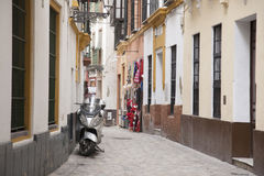 Motorbike in Street in the Santa Cruz Neighbourhood of Seville Royalty Free Stock Photography