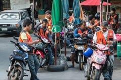 Motorbike taxi queue in Bangkok Royalty Free Stock Photography