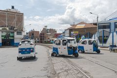 Motorbike taxi traffic. PUNO, PERU - NOVEMBER 5: crowded street traffic with many motorbike taxi vehicles in Puno, Peru on November 5, 2018 royalty free stock photo