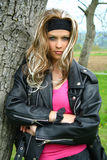 Motorbike Teen. Teen woman dressed in motorcycle jacket royalty free stock image