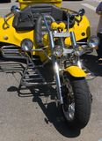 Motorbike tricycle. New yellow expensive motorbike tricycle Royalty Free Stock Photo