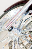 Motorbike wheel. Chromed details of motorbike front wheel Royalty Free Stock Photos