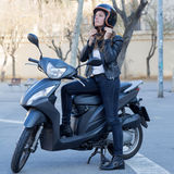 Motorbike Woman On Scooter With Helmet Royalty Free Stock Photography