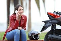 Motorbiker calling insurance after breakdown Royalty Free Stock Image