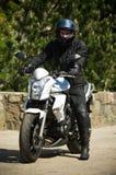 Motorbiker on his bike Royalty Free Stock Photo