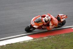 Motorbiker racer in action Stock Photos