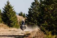 Motorbiker travelling in autumn mountains.  stock photo