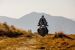 Motorbiker travelling in autumn mountains Royalty Free Stock Images