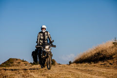 Motorbiker travelling in autumn mountains Stock Photos