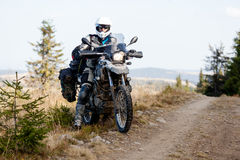 Motorbiker travelling in autumn mountains Royalty Free Stock Photography