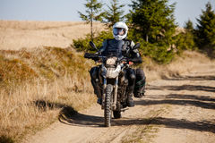 Motorbiker travelling in autumn mountains Royalty Free Stock Photo