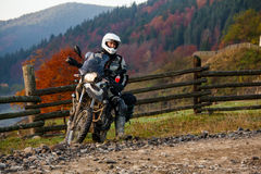 Motorbiker travelling in autumn mountains Stock Photography