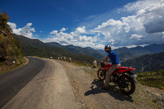 Motorbiker travelling in mountains, India Stock Photos