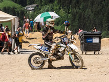 Motorbiker with umbrella. Styria, Austria - June 7, 2015: Austria, EU - June 7th, 2015: Erzberg Rodeo 2015, Motocross Mekka for MX drivers around the world Royalty Free Stock Photo