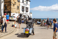 Motorbikers arrive outside The Bay Hotel. In Robin Hoods Bay Royalty Free Stock Images