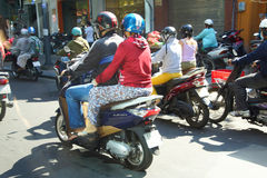 Motorbikes compete in heavy traffic of Saighon Stock Photo