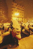 Motorbikes covered with sudden snow in Paris Stock Photography