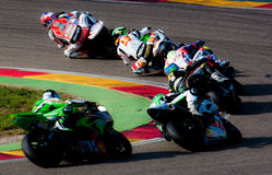Motorbikes in a curve competition Royalty Free Stock Photography
