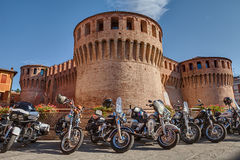 Motorbikes Harley Davidson parked near the medieval castle Stock Photo