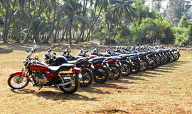 Motorbikes Lined in forest India Stock Images