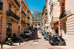 Motorbikes, motorcycles scooters parked in row in city street. Monte-Carlo, Monaco - June 28, 2015: Motorbikes, motorcycles scooters parked in row in city street Royalty Free Stock Photo
