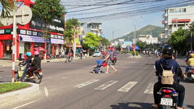 Motorbikes Move along Wide Street on Sunny Day in Vietnam stock video footage