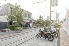 Motorbikes park beside tramway on Cashell Street near Restart Mall Stock Image