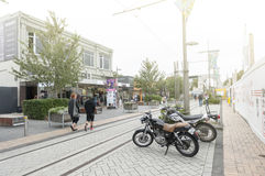 Motorbikes park beside tramway on Cashell Street near Restart Mall. Christchurch, New Zealand - February 2016: Motorbikes park beside tramway on Cashell Street Royalty Free Stock Image