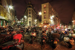 Motorbikes parked on a city street royalty free stock photo