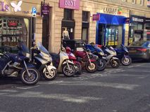 Motorbikes parked on street Stock Images