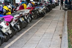 Motorbikes parked on the street of Hanoi, Vietnam.  Royalty Free Stock Image