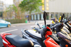 Motorbikes parked on the street of Macau Royalty Free Stock Photos