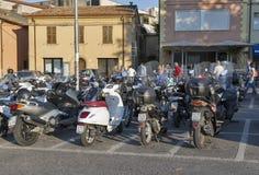 Motorbikes parking on central street of Rimini, Italy. Stock Photos