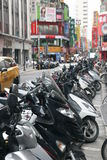 Motorbikes parking at the street in Taipei City, Taiwan Stock Photo
