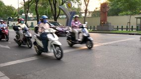 Scooters, mopeds, motorcycles, cars, traffic and people on the streets of Ho Chi Minh City, Vietnam. MOTORBIKES AND PEOPLE ON THE STREETS OF HO CHI MINH CITY OR stock footage