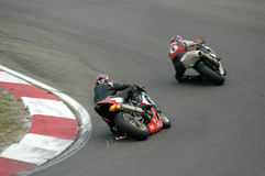 Motorbikes racing Stock Images