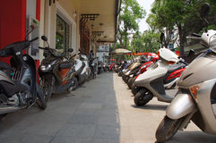 Motorbikes for rent in Hanoi. Row of Motorbikes for rent in Hanoi, Vietnam Royalty Free Stock Images