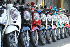 Motorbikes in a row with perspective. Line Royalty Free Stock Image