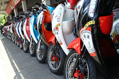 Motorbikes in a row with perspective. Line Stock Photo
