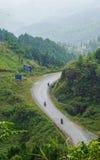 Motorbikes running on the mountain road Royalty Free Stock Photos