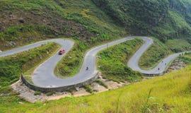 Motorbikes running on the mountain road Stock Photos