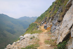 Motorbikes running on the mountain road Royalty Free Stock Images