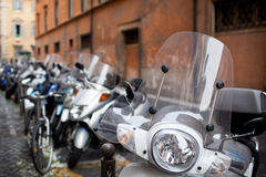 Motorbikes and scooters parked in one of the ancient streets Stock Photography