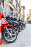 Motorbikes standing in the street in Florence. Travel Stock Photography