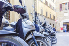 Motorbikes standing in the street in Florence. Travel Royalty Free Stock Photo
