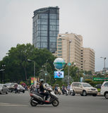 Motorbikes traffic on the street in Saigon Stock Photography
